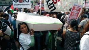 London March July 2014 Pro Palestine rally Naz Shah with coffin on her shoulder