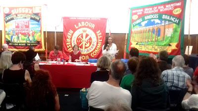 Jackie Walker speaking with John McDonnell on far-left