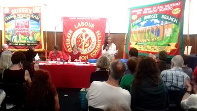 Jackie Walker speaking with John McDonnell on far-left