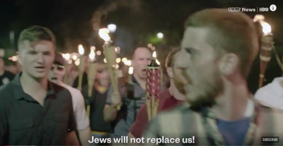 Trump's allies on the march in in Charlottesville chanting 'Jews will not replace us'