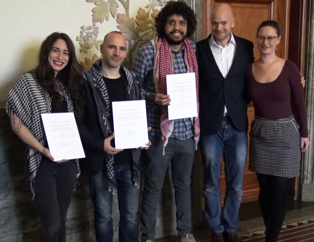 he Humboldt 3, Stavit Sinai, Ronnie Barkan, and Majed Abusalama, receive an award from Copenhagen's Mayor for Technical and Environmental Affairs, Ninna Hedeager Olsen (far right) in February 2019.